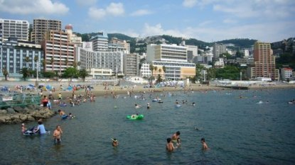 Atami beach bustling with activity during the summer!